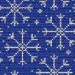 Knitted seamless winter pattern with snowflakes — Stok Vektör