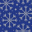 Knitted seamless winter pattern with snowflakes — ベクター素材ストック