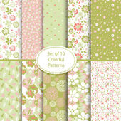 Set of 10 seamless floral and hearts background — Stok Vektör