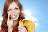 Young girl with sunscreen — Stock Photo
