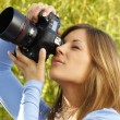 Attractive womtaking pictures outdoor — Stock Photo #26132991