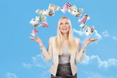 Happy woman with spread arms under money rain — Stock Photo
