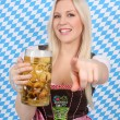 Attractive woman with dirndl and beer mug — Stock Photo #26368401