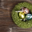 Easter eggs in easter nest — Stock Photo #26388125
