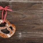 Salty pretzel on wooden background — Stock Photo #26389611