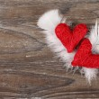 Red hearts with white feathers — Stock Photo #26392851
