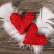 Red hearts with white feathers — Stock Photo