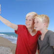 Stock Photo: Two boys picture themselves with cell phone