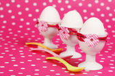 Row of egg cups for breakfast invitation — Stock Photo