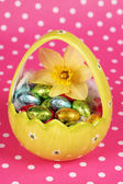 Yellow easter egg with chocolate — Stock Photo