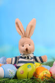 Bunny toy in easter decoration — Stock Photo
