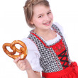 Pretty girl with dirndl and pretzel — Stock Photo