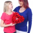 Daughter gives a flower heart to her mother — Stockfoto