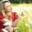 Happy woman in flower field — Stock Photo