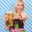 Attractive woman with dirndl and beer mug — Stock Photo #27483047