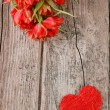 Stock Photo: Heart with red tulips