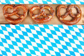 Three pretzels on checkered background — Stock Photo