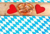 Bavarian pretzel with red hearts — Stock Photo