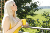 Attractive woman with a mug of hot beverage — Stock Photo
