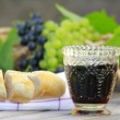 Beautiful still life with  glasses, grapes and bred — Стоковая фотография