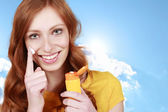 Happy woman uses sun lotion — Stock Photo
