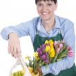 Senior woman with a bunch of tulips — Stock Photo