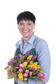 Senior woman with a bunch of tulips — Foto de Stock