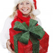 Woman with santa hat smiling — Stock Photo