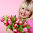 Happy smiling woman with tulip flower bunch — Stock Photo #27645279
