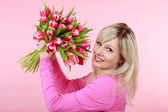 Happy smiling woman with tulip flower bunch — Foto de Stock