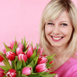 Happy smiling woman with tulip flower bunch — Stock Photo #27653177