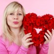 Pretty woman with red rose heart — Stock Photo