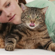 Young woman with tabby cat — Stock Photo
