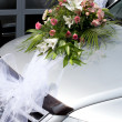 Wedding bouquet on the car — Stock Photo
