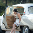 Bride in white wedding car — Stock Photo