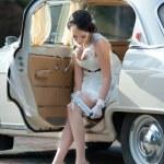 Bride in white wedding car — Stock Photo #34560983