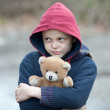 Portrait of a homeless boy with bear — Foto Stock