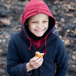 Homeless boy eats cookies — Stock Photo