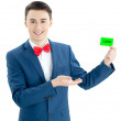 Beautiful young happy man holding a card — Stock Photo