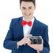 Handsome man holding a camera — Stock Photo