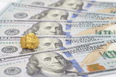 Gold and dollar bills — Stock Photo