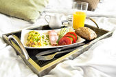 Healthy breakfast served to bed — Stock Photo