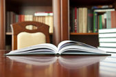 Books on a wooden table — Stock Photo