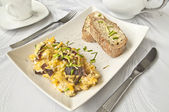Breakfast - scrambled eggs — Stock Photo