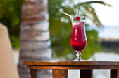 Red - orange drink at a luxury holiday resort — Stock Photo