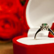 Engagement coposition - ring and roses on wooden surface — Stock fotografie