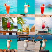 Set of nine colorful drinks by the sea — Stock Photo