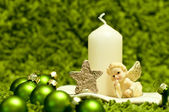 Green christmas balls and white candle — Stock Photo