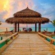 Stock Photo: Tropical hut on water at sunset