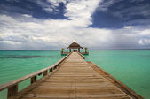 Tropical hut on water — Stock Photo